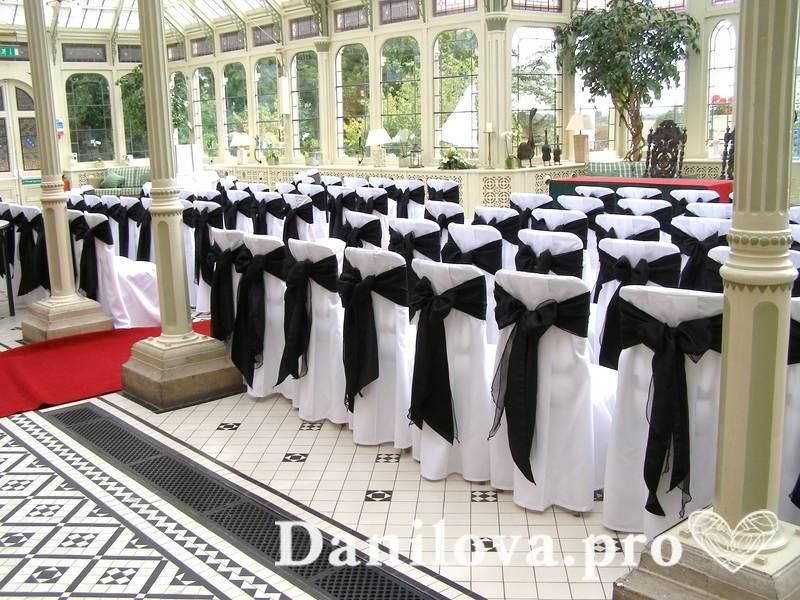 оформление стульев на свадьбу черный